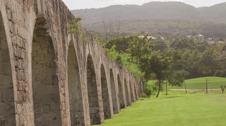 руины : Historic arches seaside ruins of an 1837 aqueduct situated on an 18th-century sugar plantation Стоковые видеозаписи