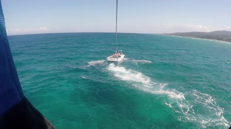 jamaica : Para sailing from back of boat in Caribbean sea - Extreme summer sports Stock Footage