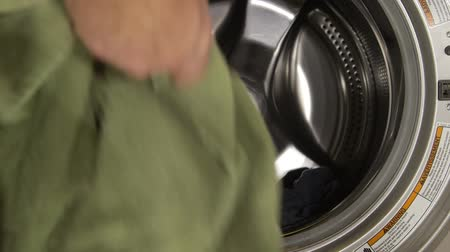 yıkayıcı : Man putting dirty clothes in washing machine - Lifestyle concept Stok Video