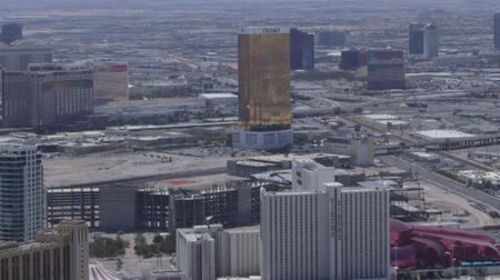 gün : Aerial view from above looking at buildings, mountains and streets of Las Vegas, Nevada, USA Stok Video