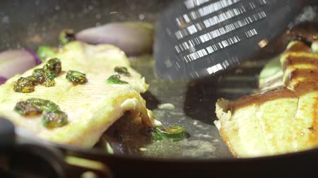 Fish fillet cooking in oil on stovetop frying pan Vídeos