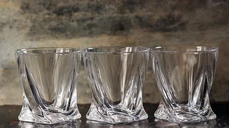 whisky : Pouring whiskey in three glasses