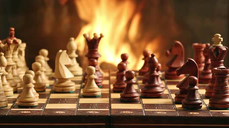 xadrez : Chess game by fireplace