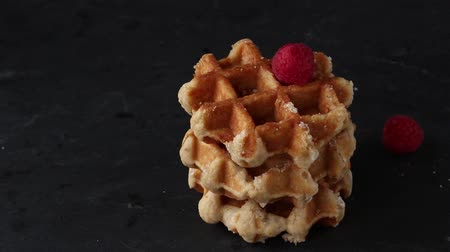 Belgian waffles with raspberries and sugar powder over rusty surface Stok Video