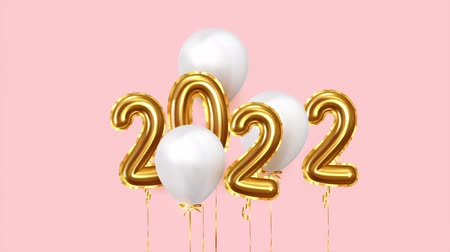 szenteste : Happy New Year 2022 golden balloons. White balloons on ribbon. Festive objects