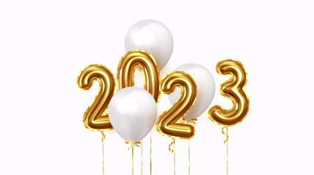 szenteste : 2023 New Year numbers golden balloons. White balloons on ribbon. Festive objects