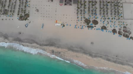 forrado : Aerial 4k footage of the beautiful beach and coastline of Cape Verde (Capo Verde) with people sunbathing on the golden sandy beach and boasts in the ocean, taken with a drone on May 2018