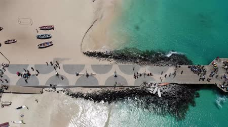 Aerial 4k footage of the famous pier at Cape Verde, fishermen with fishermens wives selling the fish on the pier, taken in Cape Verde (Capo Verde) May 2018