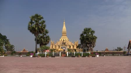 vientiane : People walking in from of Pha That Luang temple in Vientiane Laos