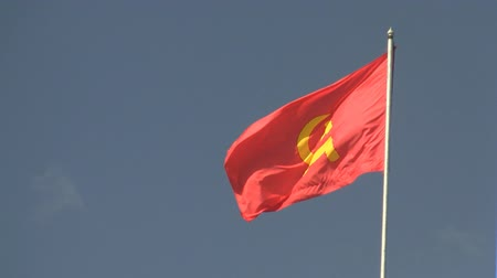 sovyet : Red flag waving against blue sky in Vientiane Laos