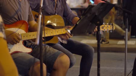 koşuşturma : Night Fair- Asian Night Market Footage. Street Musicians Play at the Fair