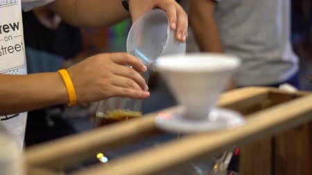 pot stickers : Brew at street market in Thailand. Fair. Night bright light Stock Footage
