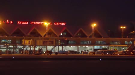busiest : Slowly Sliding Night View of New Terminal of Phuket International Airport. Thailand.