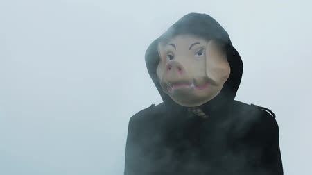 garip : Masked man pigs in the fog