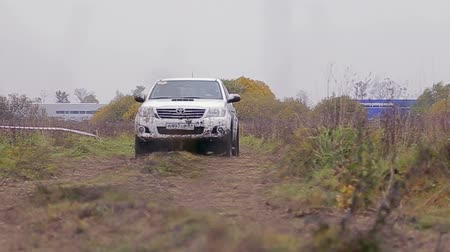Car moves on dirty road at test-drive of Toyota Center Kalinngrad on October 12, 2013 in Kaliningrad, Russia