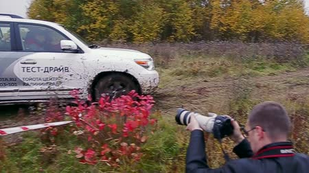 Car moves on dirty rally track at test-drive of Toyota Center Kalinngrad on October 12, 2013 in Kaliningrad, Russia