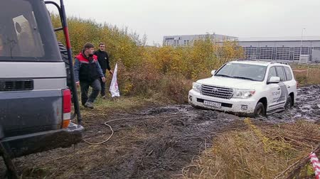 Car pulled out from dirt at test-drive of Toyota Center Kalinngrad on October 12, 2013 in Kaliningrad, Russia