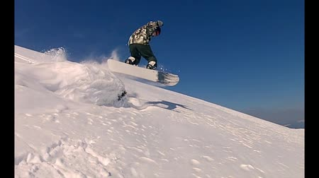 snowboard : The snowboarder is jumping over the natural snow kicker in a slow motion. Enjoy! Stok Video