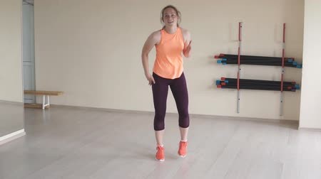 weight training : Young pretty girl mix dancing in studio. slow motion. fitness, sport, dance and lifestyle concept