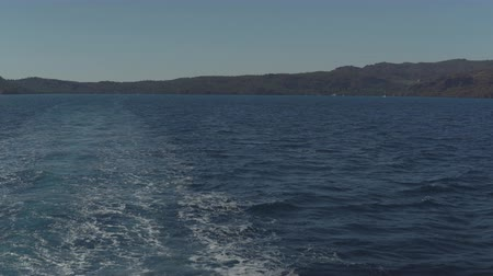 pleasure boats : trace tail of speed boat on water surface in the sea. Stock Footage