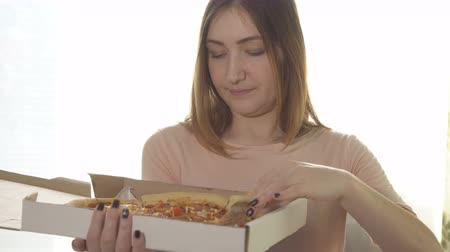 chicken pieces : Young woman eating appetizing pizza. Calorie food.