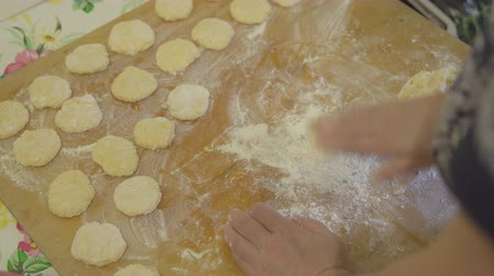 knead : Making dough pieces with womans hands at home. Stock Footage