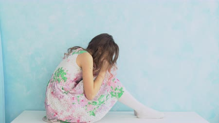 scandal : Teenage girl crying at home by covering her face with hands Stock Footage