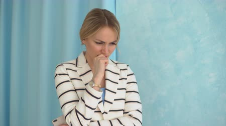 gnaw : Young alarmed woman in a striped jacket. Close-up. Stock Footage
