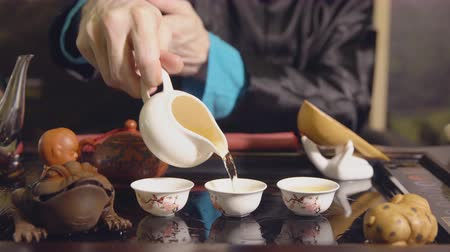 karakurbağası : Tea ceremony. Master pours the tea on the cups.