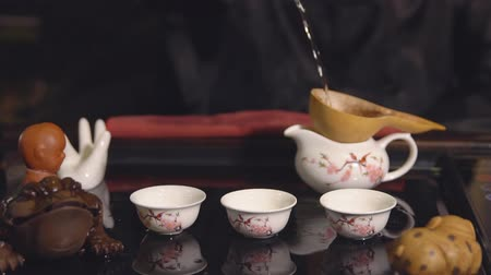 žába : Tea ceremony. Master passes through a sieve tea, slow motion