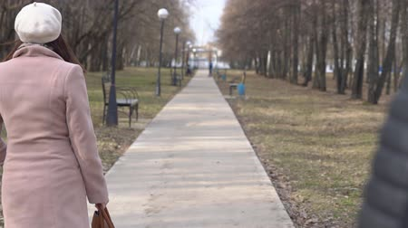 pursue : Man stole a bag of a young woman in the park. The woman does not give up, slow motion