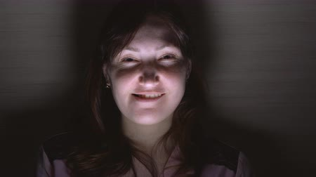 странный : Young emotional crazy woman in dark. Human emotions, facial expression concept. Стоковые видеозаписи