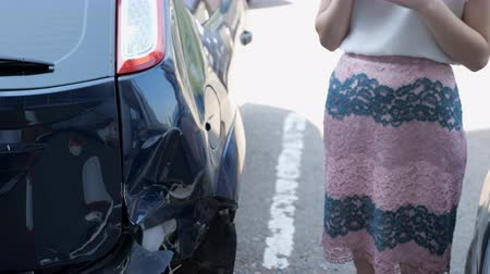 crush : brunette woman stands near a broken car.