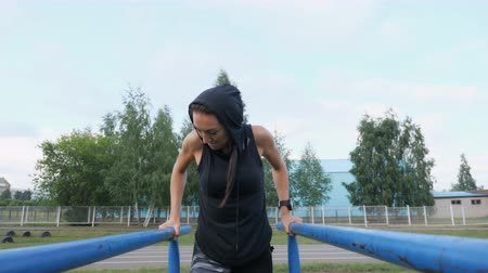 cross training : Strong girl in sportswear doing triceps exercise outdoor.