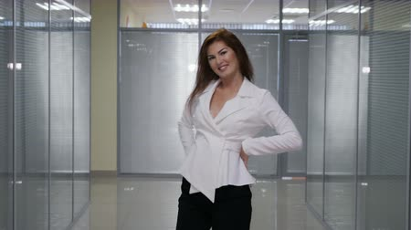 redhead suit : Beautiful happy young business woman danced in hallwall office, slow motion