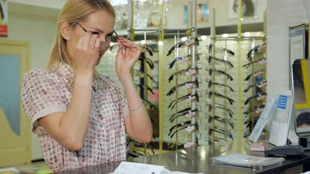 optyk : customer gets ready glasses for testing and trying.