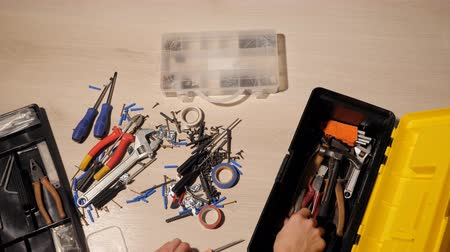 toolbox : male hands assembles tools in a box.