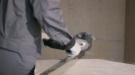 material body : Crop worker in gloves and uniform cutting metal plank with saw making sparks flying, slowmotion Stock Footage
