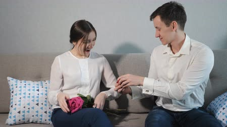 nişanlısı : Boyfriend proposing, giving wedding ring to beloved girl. Valentines Day gift. Stok Video