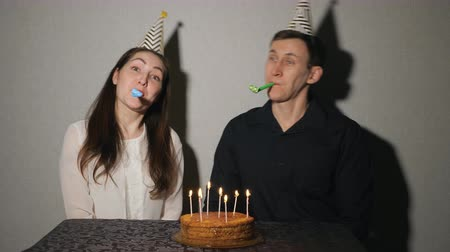 boynuzları : Crazy couple celebrates a holiday playing with party blowers, 4k