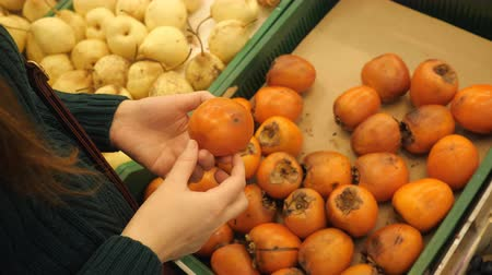 moldy : close-up of a female hand checks the persimmon, 4k Stock Footage