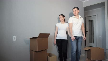 belongings : Young couple very happy and excited about moving into new apartment.