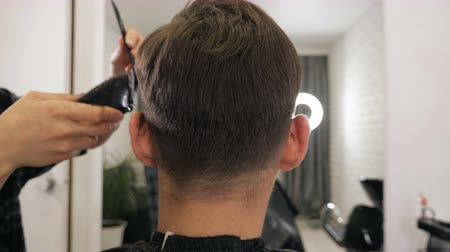 barber scissors : Female haircut with electric razor, back view