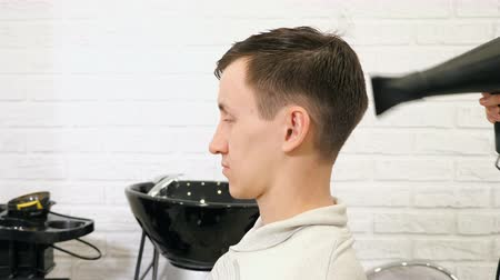 kurutma : Male hairstyle in salon. Man hair drying in barber shop, slow motion