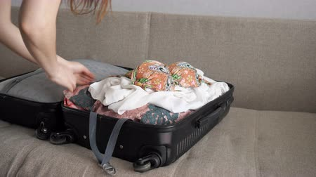 şey : close up of woman packing suitcase quickly, 4k Stok Video