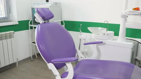 ortodontik : Dental chair and other accessories used by dentists in dental office. Modern dental practice.