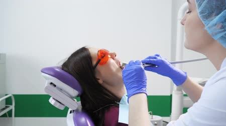 preventive : Young girl on preventive examination in dental chair at the dentist. Hands of a dentist with dental tools are checking patients teeth. Teeth care concept.