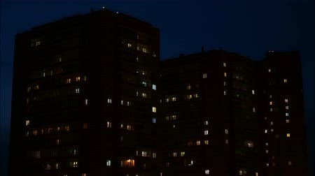 blocks of flats : Close up view to windows in apartment buildings at night, timelapse. 4k Stock Footage