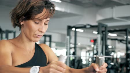 contra : close up of sportive woman is doing exercises for spine muscles on block simulator, front view. Stock Footage
