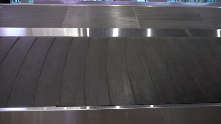 istek : Closeup of empty moving luggage conveyor belt in arrivals lounge of airport terminal for passengers.